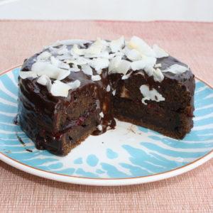 Mini cake with cherries, chocolate and coconut flakes.